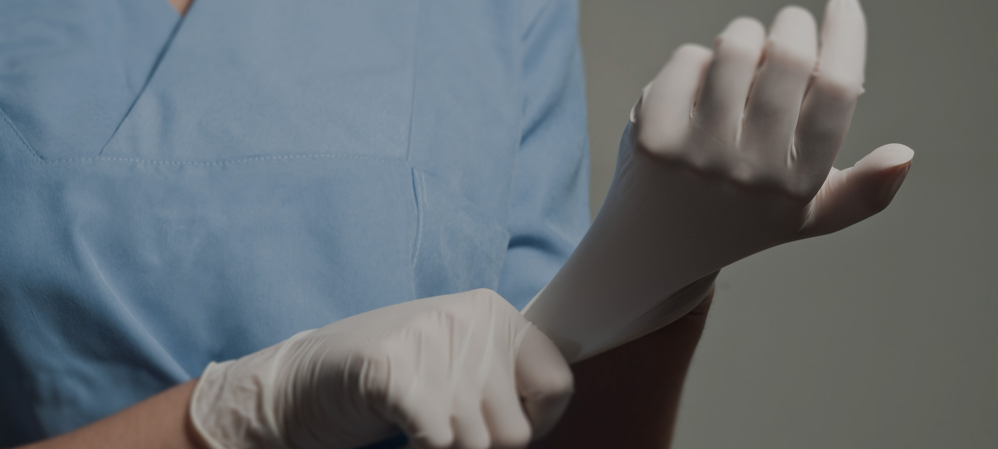 Image of a surgeon putting on gloves
