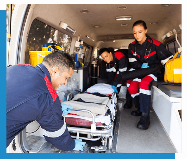 Image of emergency paramedics taking a stretcher out of an ambulance