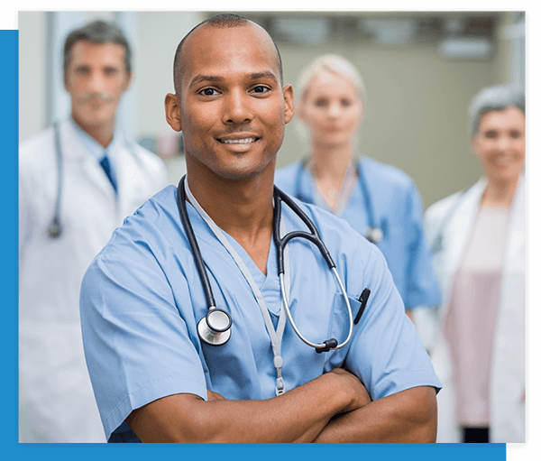 Image of a confident surgeon with 3 other nurses and doctors in the background